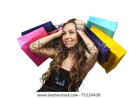 Lovely stylish woman with shopping bags over white - stock photo