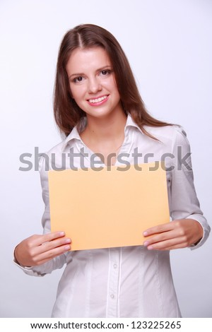 Lovely successful business woman holding a banner for your special text