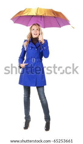 Lovely surprised woman in a blue coat with umbrella against white background - stock photo