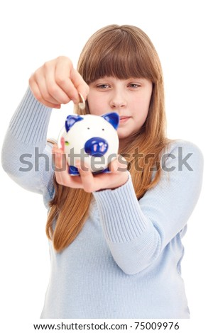 lovely teenage girl putting coin in piggy bank, close up - stock photo
