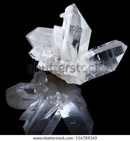 Lovely terminated white rock crystal with reflection against black background  - stock photo