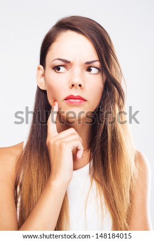Lovely thoughtful woman against white background - stock photo