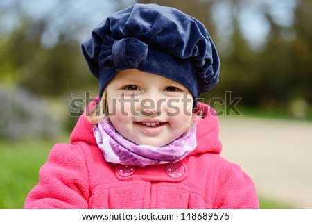 lovely toddler with sweet smile - stock photo