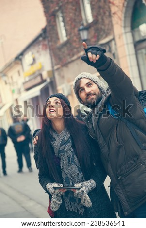 Lovely Tourists Couple Sightseeing The City - stock photo