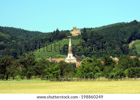Lovely town of Kintzheim, Alsace, France, with the church, vineyards and the old castle - stock photo