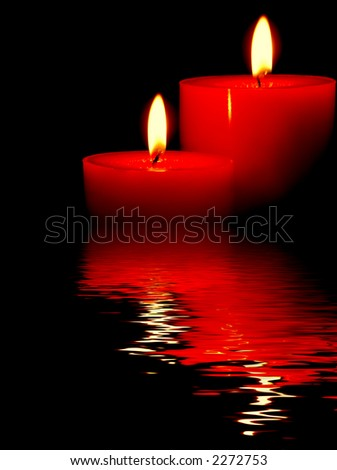 lovely twin candles with perfect flames in rendered water - stock photo