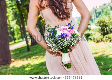 Lovely wedding bouquet and bride in a big day - stock photo