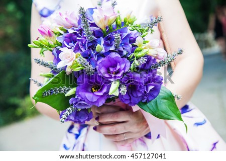 Lovely wedding bouquet and bride in a big day