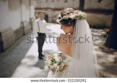 lovely wedding couple oditi a crown of butterflies and suspenders - stock photo