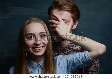 lovely white caucasian couple in love studio indoor portrait smiling teeth - stock photo