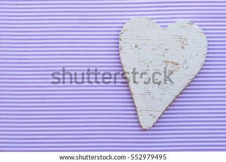 Lovely white heart shape on violet striped fabric background for Valentines Day, Mothers Day or Birthday.