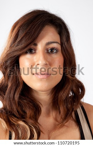 Lovely white woman with long brown hair,  looking at the camera with a friendly smile - stock photo