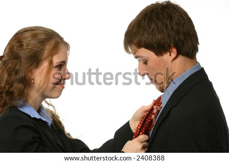 Lovely wife fixing attractive husband's tie - stock photo