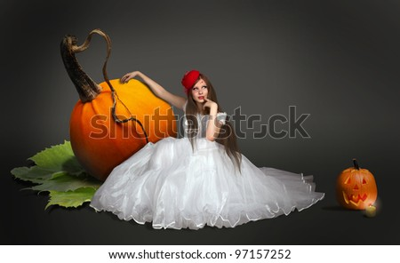 Lovely witch with pumpkins. Cinderella. - stock photo
