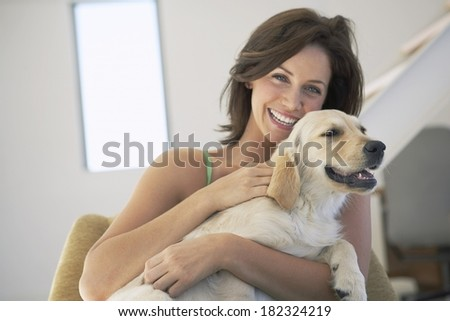 Lovely woman and dog at home - stock photo