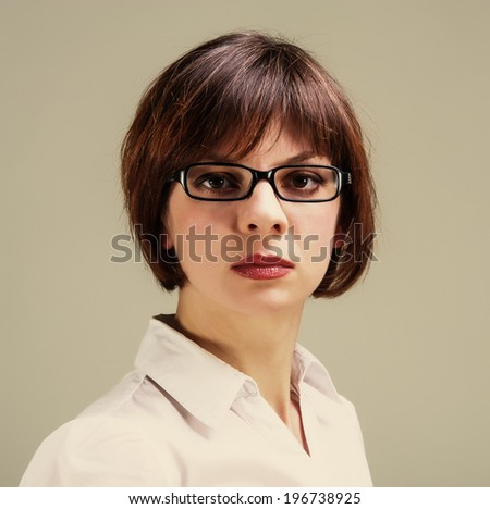 Lovely woman businesswoman in glasses looking into the camera, portrait, close up