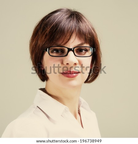 Lovely woman businesswoman in glasses looking into the camera, portrait, closeup