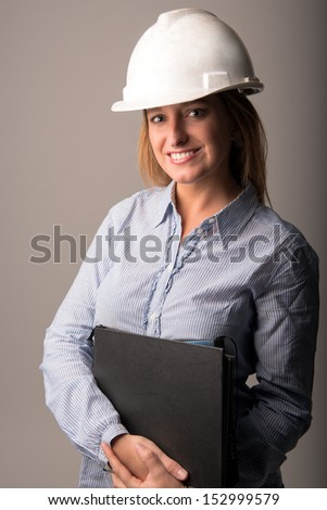Lovely woman engineer doing business - stock photo