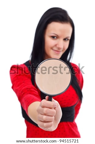 Lovely woman holding a magnifying glass, focus on it
