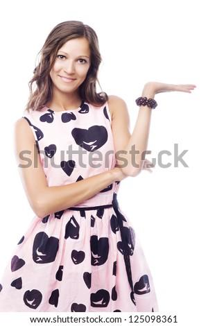Lovely woman holding something imaginary - stock photo