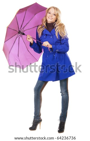 Lovely woman in a blue coat with umbrella against white background - stock photo