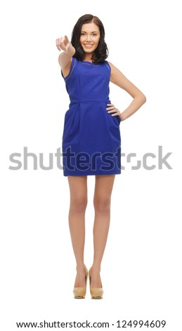 lovely woman in blue dress pointing her finger - stock photo