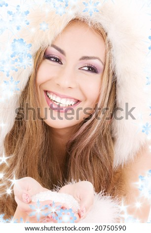 lovely woman in fur with handful of ice - stock photo