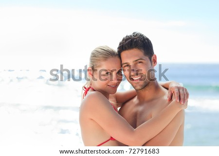 Lovely woman in her boyfriend's arms