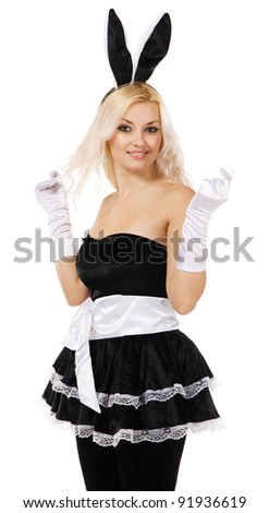 Lovely woman in rabbit costume, white background - stock photo