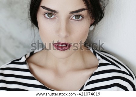 Lovely woman in striped shirt - stock photo