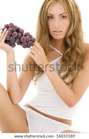 lovely woman in white cotton underwear with bunch on dark grapes - stock photo
