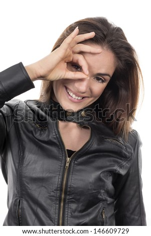 lovely woman looking through hole from fingers  - stock photo