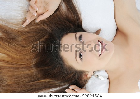 lovely woman lying on the bed. Isolated on white background