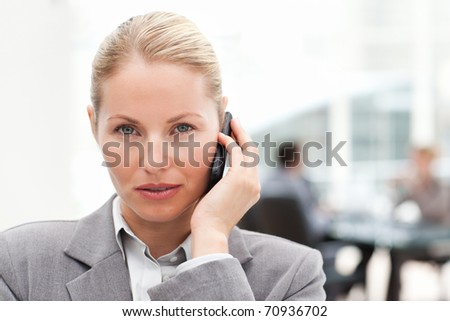 Lovely woman phoning in her office