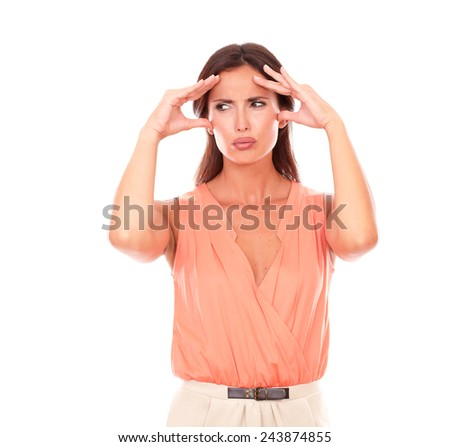 Lovely woman suffering from migraine headache with hand on head and looking to her right in white background - copyspace
