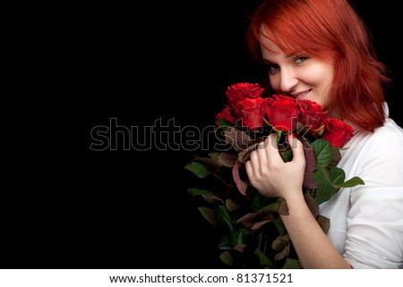 lovely woman with a bouquet of red roses, black background