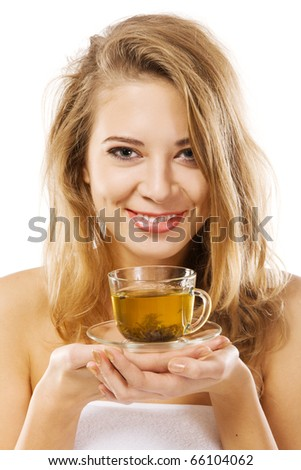 Lovely woman with a cup of green tea - stock photo