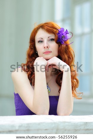 Lovely woman with a flower in her hairs - stock photo