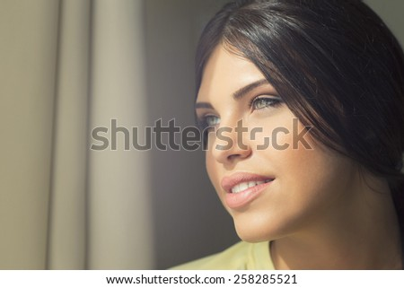 Lovely woman with a soft skin and beautiful blue eyes - stock photo