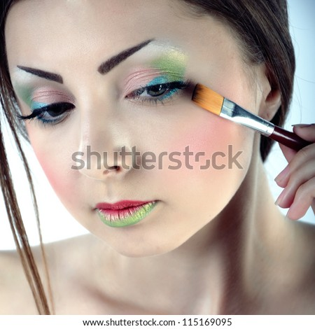 lovely woman with brush - stock photo
