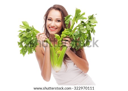 Lovely woman with celery on white background - stock photo