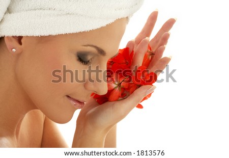 lovely woman with red flower petals - stock photo
