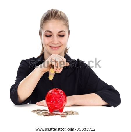 Lovely woman with red piggy bank and falling coins - stock photo