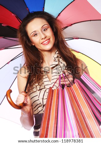 lovely woman with shopping bags and umbrella