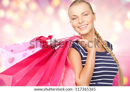 lovely woman with shopping bags over colorful background - stock photo