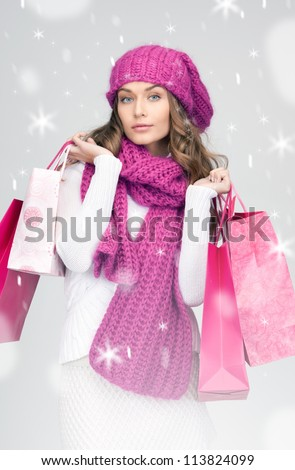 lovely woman with shopping bags over white. - stock photo
