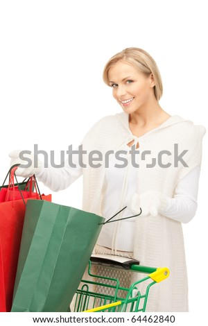 lovely woman with shopping cart over white
