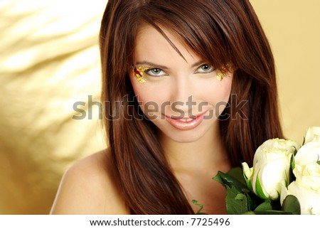 lovely woman with white rose over gold background