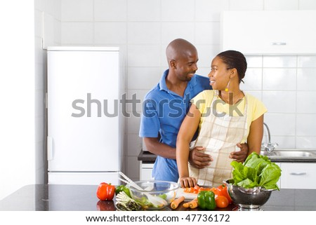lovely young african american couple in modern kitchen