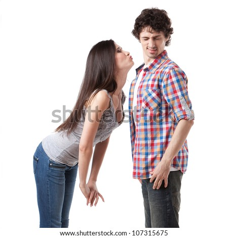 Lovely young couple having fun by pretending that are kissing. - stock photo